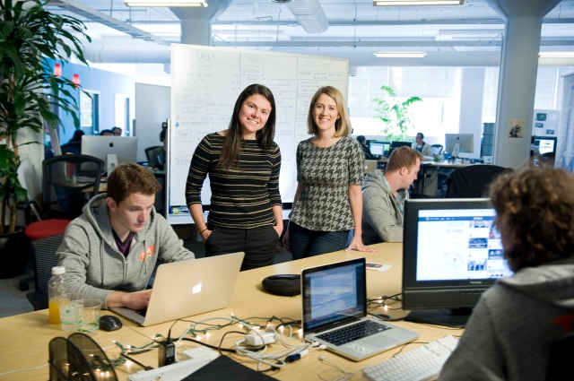 """Tumml- Julie Lein (president) and Clara Brenner CEO of Tumml at their company's desk space at the""""Hatch""""  space in San Francisco."""